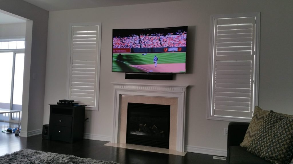 TV Mounted Over Fireplace with Wires Concealed in the Wall